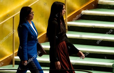 Stock Picture of Vice President of Venezuela Delcy Rodriguez, left, approaches the podium before addressing the 74th session of the United Nations General Assembly, at the United Nations headquarters