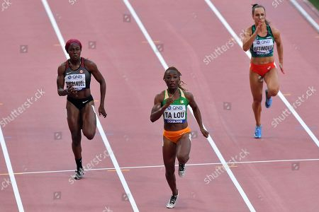 Stock Picture of Crystal Emmanuel, of Canada, Marie-Josée Ta Lou, of The Ivory Coast, and Inna Eftimova, of Bulgaria, from left, compete in a women's 100 meter race heat during the World Athletics Championships in Doha, Qatar