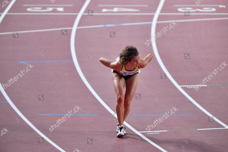 Alina Reh, of Germany, quits the women's 10,000 meter race during the World Athletics Championships in Doha, Qatar