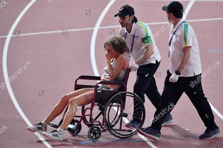 Alina Reh, of Germany, leaves the track on a wheelchair after quitting the women's 10,000 meter race during the World Athletics Championships in Doha, Qatar