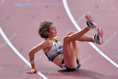 Alina Reh, of Germany, falls down on the track and quits the women's 10,000 meter race during the World Athletics Championships in Doha, Qatar