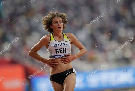 Alina Reh of Germany pulls up injured in the women's 10,000m final at the World Athletics Championships in Doha, Qatar