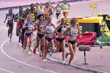 Alina Reh, of Germany, right, leads the women's 10,000 meter race during the World Athletics Championships in Doha, Qatar