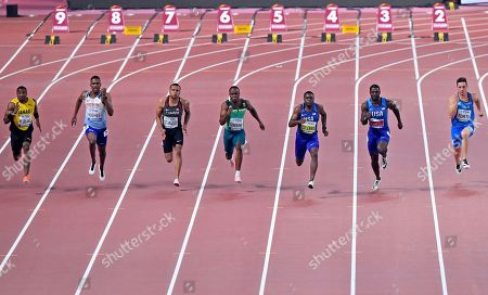 Yohan Blake, of Jamaica, Zharnel Hughes, of Great Britain, Andre De Grasse, of Canada, Akani Simbine, of South Africa, Christian Coleman, of the United States, Justin Gatlin, of the United States, and Filippo Tortu, of Italy, from left, compete in the men's 100 meter race during the World Athletics Championships in Doha, Qatar