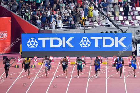 Aaron Brown, of Canada, Yohan Blake, of Jamaica, Zharnel Hughes, of Great Britain, Andre De Grasse, of Canada, Akani Simbine, of South Africa, Christian Coleman, of the United States, Justin Gatlin, of the United States, and Filippo Tortu, of Italy, from left, start in the men's 100 meter race during the World Athletics Championships in Doha, Qatar