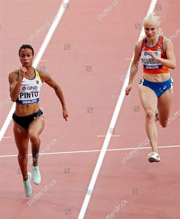 Tatjana Pinto (L) of Germany and Marije Van Hunenstijn (R) of the Netherlands in action during the women's 100m heats during the IAAF World Athletics Championships 2019 at the Khalifa Stadium in Doha, Qatar, 28 September 2019.