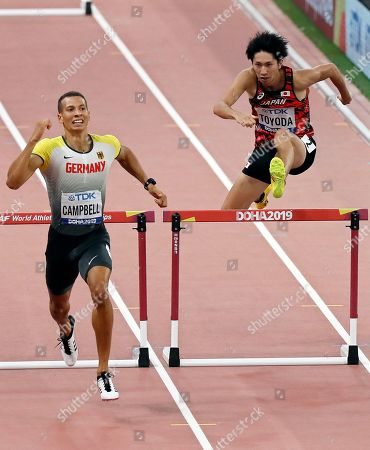 Luke Campbell (L) of Germany and Masaki Toyoda (R) of Japan compete in the men's 400m Hurdles semi finals at the IAAF World Athletics Championships 2019 at the Khalifa Stadium in Doha, Qatar, 28 September 2019.