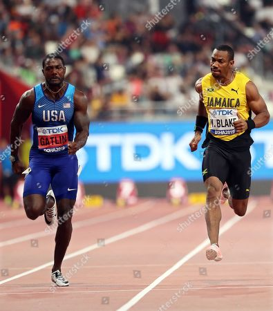 Justin Gatlin (L) of the USA and Yohan Blake (R) of Jamaica compete in the men's 100m semi finals at the IAAF World Athletics Championships 2019 at the Khalifa Stadium in Doha, Qatar, 28 September 2019.