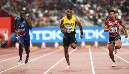 (L-R) Justin Gatlin of the USA, Yohan Blake of Jamaica, and Yuki Koike of Japan compete in the men's 100m semi finals at the IAAF World Athletics Championships 2019 at the Khalifa Stadium in Doha, Qatar, 28 September 2019.