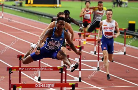 TJ Holmes (L) of the USA in action during the men's 400m Hurdles semi finals at the IAAF World Athletics Championships 2019 at the Khalifa Stadium in Doha, Qatar, 28 September 2019.