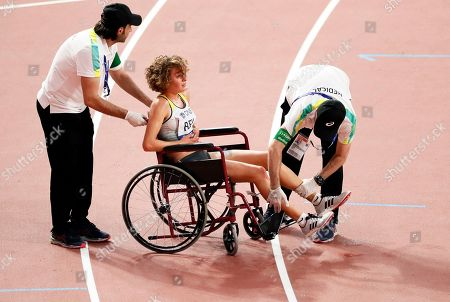 Stock Photo of Alina Reh (C) of Germany receives medical assistance during the women's 10,000m final during the IAAF World Athletics Championships 2019 at the Khalifa Stadium in Doha, Qatar, 28 September 2019.