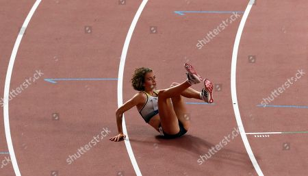 Alina Reh of Germany collapses during the women's 10,000m final during the IAAF World Athletics Championships 2019 at the Khalifa Stadium in Doha, Qatar, 28 September 2019.