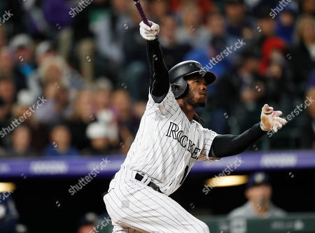 R m. Colorado Rockies pinch-hitter Raimel Tapia follows the flight of his grand slam off Milwaukee Brewers relief pitcher Jay Jackson in the sixth inning of a baseball game, in Denver