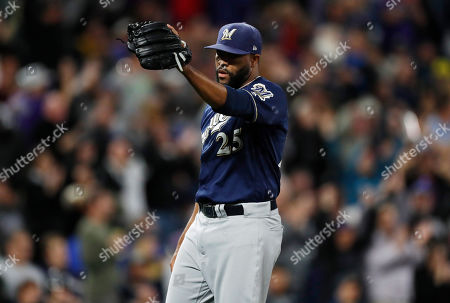 R m. Milwaukee Brewers relief pitcher Jay Jackson calls for a new ball after giving up a grand slam to Colorado Rockies pinch hitter Raimel Tapia in the sixth inning of a baseball game, in Denver