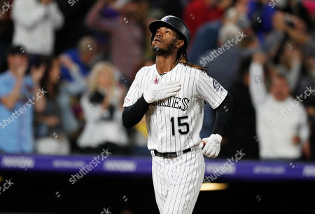 R m. Colorado Rockies pinch hitter Raimel Tapia gestures as he circles the bases after hitting a grand slam off Milwaukee Brewers relief pitcher Jay Jackson in the sixth inning of a baseball game, in Denver