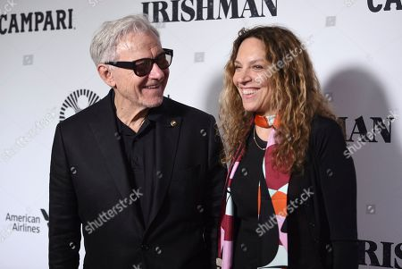 """Harvey Keitel, left, and Daphna Kastner attend the world premiere of """"The Irishman"""" at Alice Tully Hall during the opening night of the 57th New York Film Festival, in New York"""