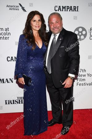 "Stock Image of Bo Dietl, right, and guest attend the world premiere of ""The Irishman"" at Alice Tully Hall during the opening night of the 57th New York Film Festival, in New York"