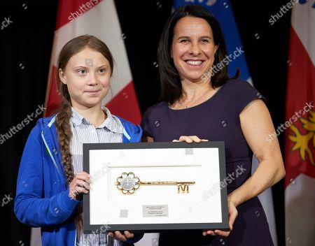 Stock Photo of Swedish climate activist Greta Thunberg (L) receives the key to the city from the Mayor of Montreal Valerie Plante (R) following the climate strike in Montreal, Quebec, Canada, 27 September 2019. Thunberg participated in several climate events in Montreal, continuing a month-long series of climate-related appearances in the US and Canada which began with her sailing from England to New York in late August.