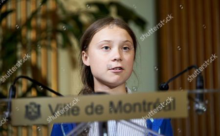 Stock Picture of Swedish climate activist Greta Thunberg speaks at the Montreal city hall after she received the key to the city from the Mayor of Montreal Valerie Plante (not pictured) following the climate strike in Montreal, Quebec, Canada, 27 September 2019. Thunberg participated in several climate events in Montreal, continuing a month-long series of climate-related appearances in the US and Canada which began with her sailing from England to New York in late August.
