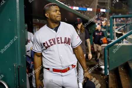 Cleveland Indians' Yasiel Puig walks out of the dugout after a baseball game against the Washington Nationals, in Washington