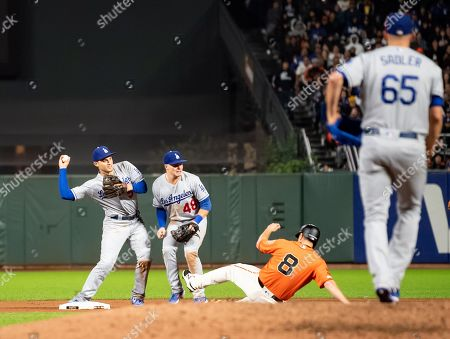 Los Angeles Dodgers shortstop Corey Seager (5) and second baseman Gavin Lux (48) try to turn a double play as San Francisco Giants left fielder Alex Dickerson (8) slides into second base, during a MLB game between the Los Angeles Dodgers and the San Francisco Giants at Oracle Park in San Francisco, California