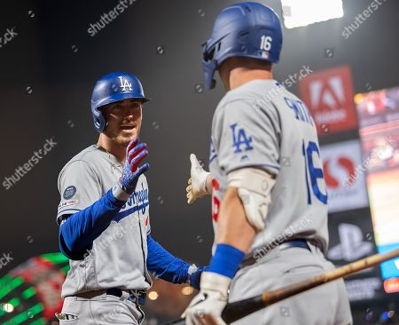 Los Angeles Dodgers shortstop Corey Seager (5) is congratulated by catcher Will Smith (16) after his second inning solo home run, during a MLB game between the Los Angeles Dodgers and the San Francisco Giants at Oracle Park in San Francisco, California