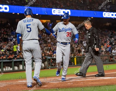 Los Angeles Dodgers center fielder Cody Bellinger (35) is congratulated for a solo home run by shortstop Corey Seager (5), during a MLB game between the Los Angeles Dodgers and the San Francisco Giants at Oracle Park in San Francisco, California