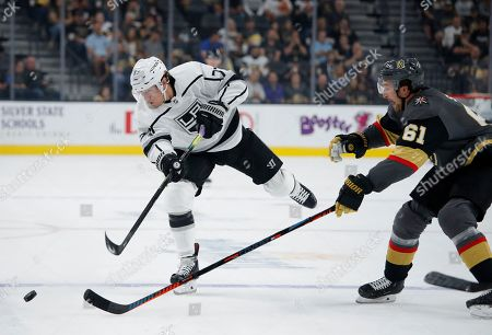 Los Angeles Kings right wing Tyler Toffoli (73) hits the puck upice against Vegas Golden Knights right wing Mark Stone during the first period of an NHL preseason hockey game, in Las Vegas