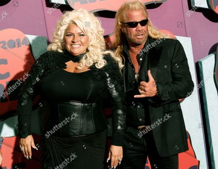 """Beth Chapman, Duane Chapman. Beth Chapman, left, and Duane Chapman arrive at the CMT Music Awards at Bridgestone Arena, in Nashville, Tenn. Chapman, known to millions as the star of the """"Dog the Bounty Hunter"""" reality TV show, tells People magazine that he is facing his own medical problems after the death of his wife from cancer. Chapman, 66, appeared on an episode of """"The Dr. Oz Show"""", in which he learned that he's suffering from a pulmonary embolism in the heart - meaning one or more of his arteries has been blocked by blood"""