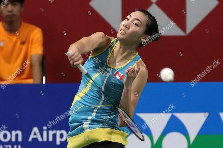 Stock Photo of Canada's Michelle Li returns a shot during women's semi-final match against China's He Bing Jiao at the Korea Open Badminton in Incheon, South Korea