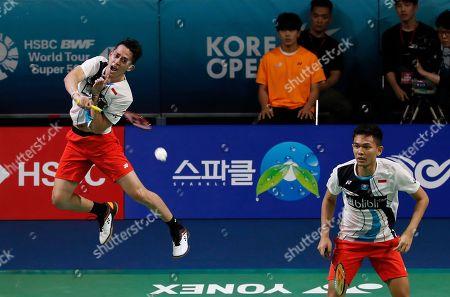 Fajar Alfian, Muhammad Rian Ardianto. Indonesia's Muhammad Rian Ardianto, left, returns a shot near his teammate Fajar Alfian during the men's doubles semi-final match against China's Li Jun Hui and Liu You Chen at the Korea Open Badminton in Incheon, South Korea