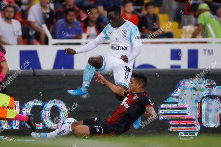 Stock Photo of Anderson Santamaria (bottom) of Atlas vies for the ball with Ake Loba (top) of Queretaro during a Liga MX soccer tournament match at Jalisco stadium in Guadalajara, Mexico, 27 September 2019.