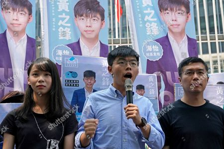 Joshua Wong, Agnes Chow, Au Nok-hin. Hong Kong democratic activists, Joshua Wong, center, is accompanied with Agnes Chow, left and pro-democracy lawmaker Au Nok-hin, speaks to the media in Hong Kong, . Wong announced plans to contest local elections and warns that any attempt to disqualify him will only spur more support for monthslong pro-democracy protests