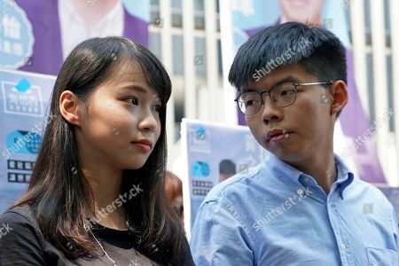 Joshua Wong, Agnes Chow. Hong Kong democratic activists Joshua Wong, right, chats with Agnes Chow, as they meet the media in Hong Kong, . Wong announced plans to contest local elections and warns that any attempt to disqualify him will only spur more support for monthslong pro-democracy protests