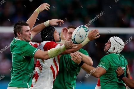 Japan's James Moore battles for the ball with Irish defenders during the Rugby World Cup Pool A game at Shizuoka Stadium Ecopa between Japan and Ireland in Shizuoka, Japan