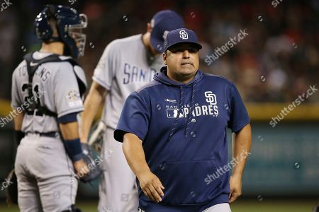Stock Photo of San Diego Padres interim manager Rod Barajas walks back to the dugout after visiting the mound during the fifth inning of a baseball game against the Arizona Diamondbacks, in Phoenix