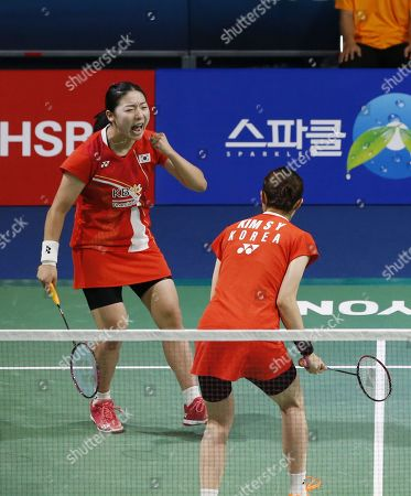Kong Hee-yong (L) and Kim So-yeong (R) of South Korea react after winning against Ayako Sakuramoto and Yukiko Takahata of Japan  during their Women's Doubles semi-final match of the Korea Open 2019 badminton championships in Incheon, South Korea, 28 September 2019.