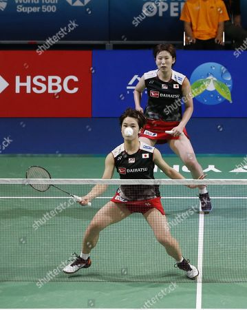 Stock Photo of Yukiko Takahata (front) and Ayako Sakuramoto (back) of Japan in action during their Women's Doubles semi-final match against  Kong Hee-yong and Kim So-yeong of South Korea at the Korea Open 2019 badminton championships in Incheon, South Korea, 28 September 2019.