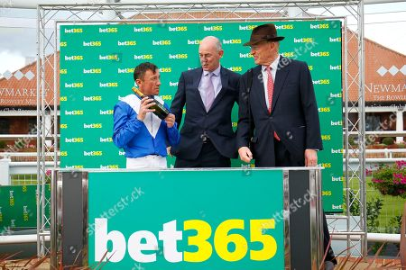 Frankie Dettori and John Gosden after winning the Bet365 Cambridgeshire Handicap at Newmarket with Lord North.