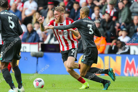 Sheffield United forward Oli McBurnie (9) under pressure from Liverpool midfielder Fabinho (3) during the Premier League match between Sheffield United and Liverpool at Bramall Lane, Sheffield