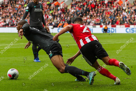 Liverpool midfielder Fabinho (3) is pulled back by Sheffield United defender George Baldock (2) during the Premier League match between Sheffield United and Liverpool at Bramall Lane, Sheffield