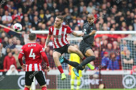 Sheffield United forward Oli McBurnie (9) and Liverpool midfielder Fabinho (3) compete for the ball during the Premier League match between Sheffield United and Liverpool at Bramall Lane, Sheffield