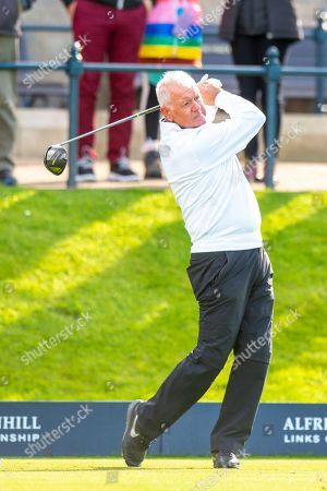 Gerry McIlory, the father of Rory McIlroy plays his tee shot from the first hole during the third round of the Alfred Dunhill Links Championship European Tour at St Andrews, West Sands