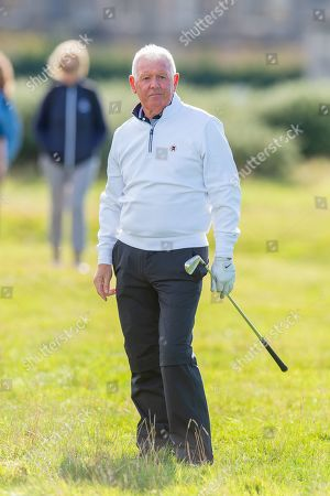 Gerry McIlory, the father of Rory McIlroy watches his approach shot from the rough on the second hole during the third round of the Alfred Dunhill Links Championship European Tour at St Andrews, West Sands