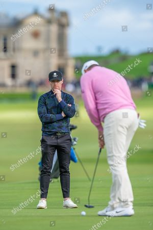 Stock Picture of Ronan Keating watches his playing partner Lee Westwood putt out on the 17th green during the third round of the Alfred Dunhill Links Championship European Tour at St Andrews, West Sands