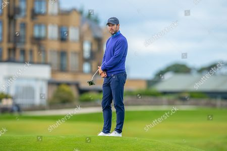 Former Liverpool footballer and Sky Sports pundit Jamie Redknapp waits to putt on the 17th green during the third round of the Alfred Dunhill Links Championship European Tour at St Andrews, West Sands