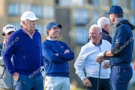 Rory McIlroy and his father Gerry McIlroy share a joke with retired cricketer Kevin Pietersen whilst waiting to tee off on the 18th hole during the third round of the Alfred Dunhill Links Championship European Tour at St Andrews, West Sands
