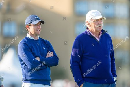 Stock Photo of Rory McIlroy (Left) and Dermot Desmond wait to tee off on the 18th hole during the third round of the Alfred Dunhill Links Championship European Tour at St Andrews, West Sands