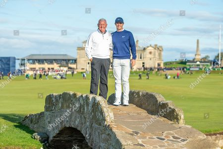 Stock Image of Rory McIlroy and his father Gerry McIlroy pose for pictures on the Swilken Bridge on the 18th hole during the third round of the Alfred Dunhill Links Championship European Tour at St Andrews, West Sands
