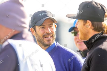 Former Liverpool footballer and Sky Sports pundit, Jamie Redknapp chats with Ryan Smith on the second tee during the third round of the Alfred Dunhill Links Championship European Tour at St Andrews, West Sands